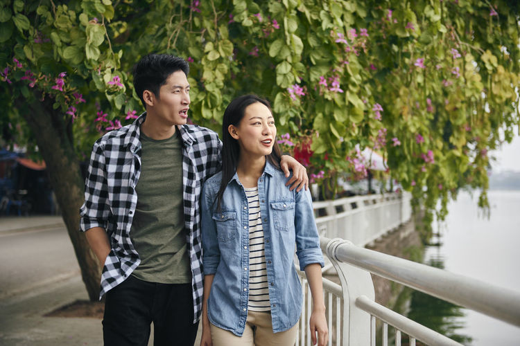 Young couple standing outdoors