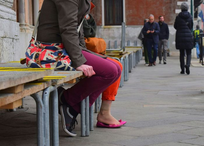 Low Section Human Body Part People Sitting On Benches Venice, Italy EyeEm Best Shots Street Photography The Week On EyeEm Pink Color Be. Ready. An Eye For Travel Stories From The City Adventures In The City Summer Road Tripping The Street Photographer - 2018 EyeEm Awards 10
