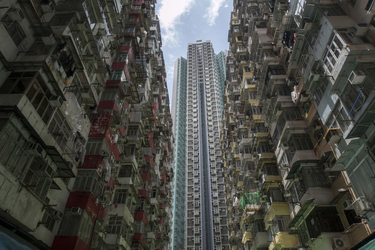 Hong Kong HongKong Apartment Architecture Building Building Exterior Built Structure City City Life Cityscape Day Location Low Angle View Modern Neighborhood No People Office Building Exterior Outdoors Place Residential District Sky Skyscraper Tall - High Tower Travel Destinations