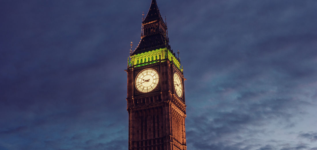 Low angle view of big ben against cloudy sky during dusk