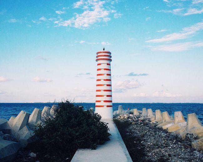 Lighthouse Against Sea