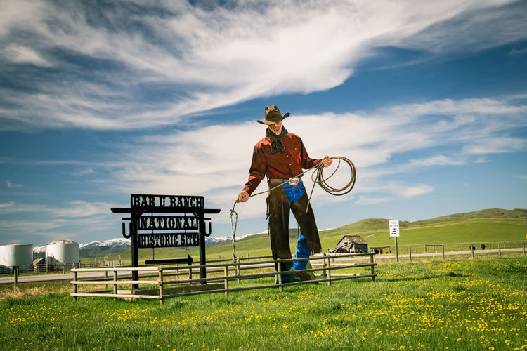 Cowboy road sign in Longview, Alberta, outside of Calgary Alberta Cowboy Longview Rope Wild West Canada Cloud - Sky Day Field Full Length Grass Lasso Men Nature Outdoors Prairie Road Sign Sky Standing