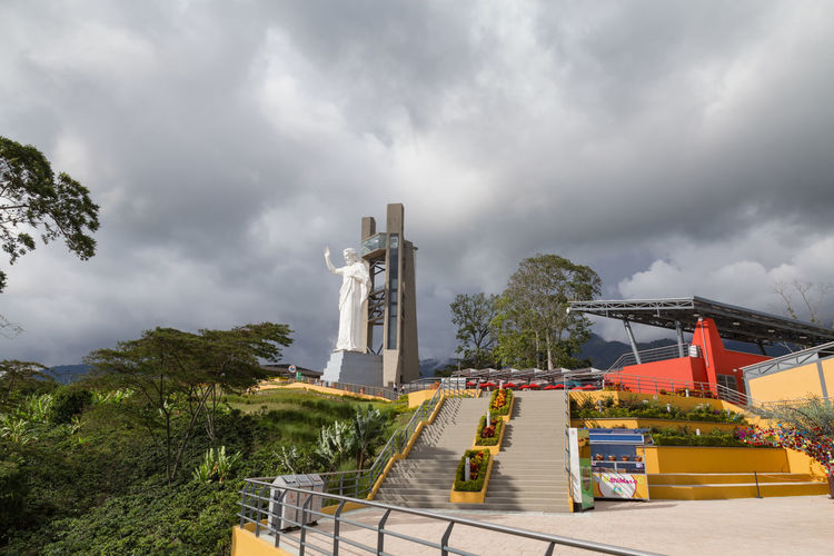 FLORIDABLANCA, COLOMBIA - MAY 3: Wide angle view of the beautiful El Santisimo Jesus Statue in the El Santisimo Eco Park in Floridablanca, Colombia on May 3, 2016. Catholic Colombia Eco Park Floridablanca Jesus Latin America Santander Statue Architecture Bucaramanga Christ Ecoparque El Santisimo Jungle Landmark Landscape Nature No People Outdoors Park Santisimo Sculpture South America Theme White