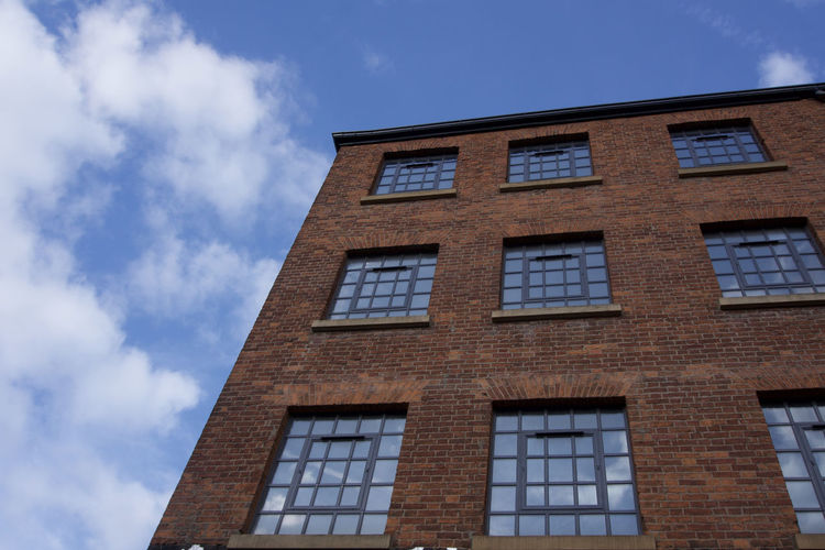 Northern Quarter building detail in Manchester, UK Manchester Day Architecture No People Built Structure Window Low Angle View Building Exterior Sky Cloud - Sky Building Nature Blue Outdoors Sunlight Brick City Residential District Glass - Material In A Row Wall Apartment
