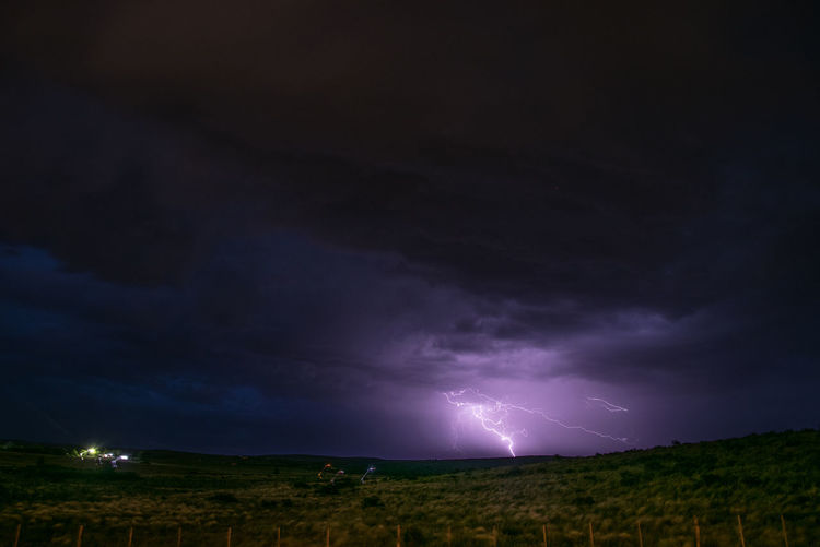 Sky Storm Lightning Night Power In Nature Thunderstorm Beauty In Nature Cloud - Sky Environment Scenics - Nature Power No People Nature Landscape Warning Sign Illuminated Storm Cloud Sign Communication Outdoors Dark Ominous Purple