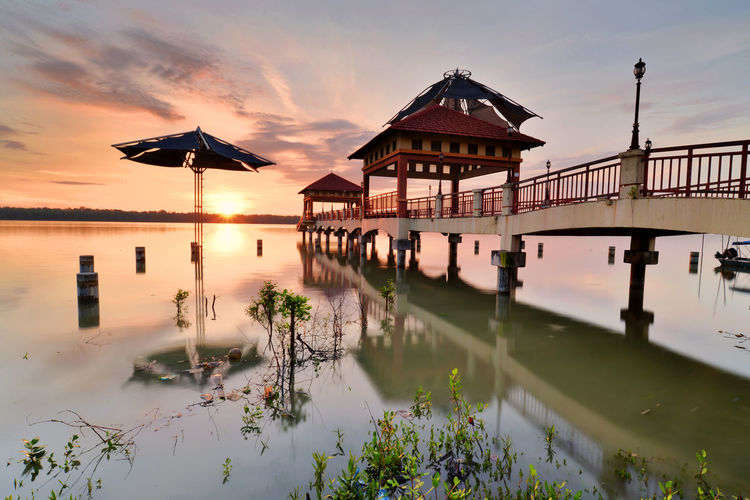 Leguna Park Jetty Water Sunset Stilt House Reflection Cultures Sky Architecture Landscape Cloud - Sky Travel Boat Silhouette Floating On Water Floating