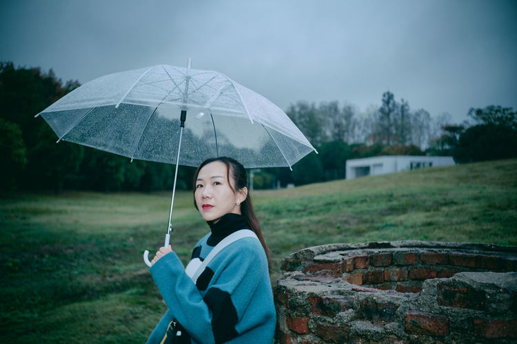 One Person Umbrella Portrait Real People Standing Protection Lifestyles Waist Up Holding Casual Clothing Focus On Foreground Young Adult Women Looking At Camera Leisure Activity Nature Security Land Rain Outdoors This Is Natural Beauty