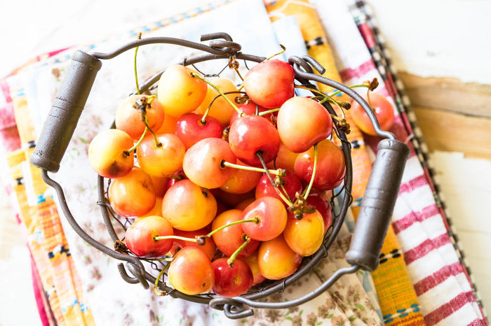 basket of sweet cherries on a pile on napkins Abundance Bunch Cherries, Well Pump,summer,flower Garden, Colors Day Focus On Foreground Food Food And Drink Freshness Fruit Healthy Eating Large Group Of Objects Nakieken Organic Ready-to-eat Selective Focus Serving Size Sweet Sweets