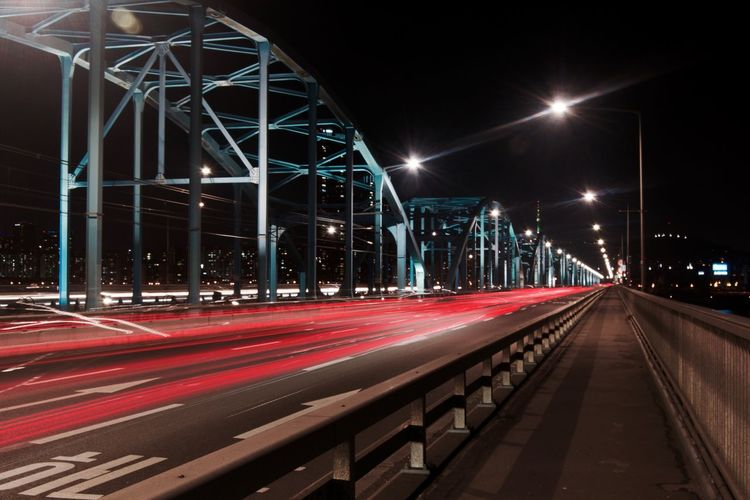 Architecture Bridge - Man Made Structure Built Structure City Connection Illuminated Light Trail Long Exposure Motion Neon Night No People Outdoors Sky Speed Street Light Transportation