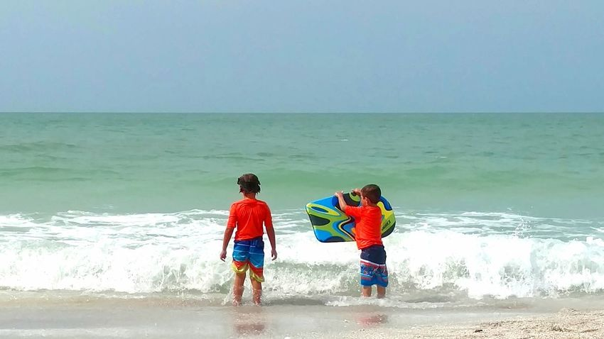 Lido Key Beach Sarasota, FL Kids Playing At The Beach Child With Boogie Board Children Photography Children Playing On Beach Children Playing In Ocean Boogie Board Ocean Waves Travel Photography Beach Photography Beach Day Children Frolicking Salt Life Salt Water Ocean View Sarasota Florida Gulf Of Mexico