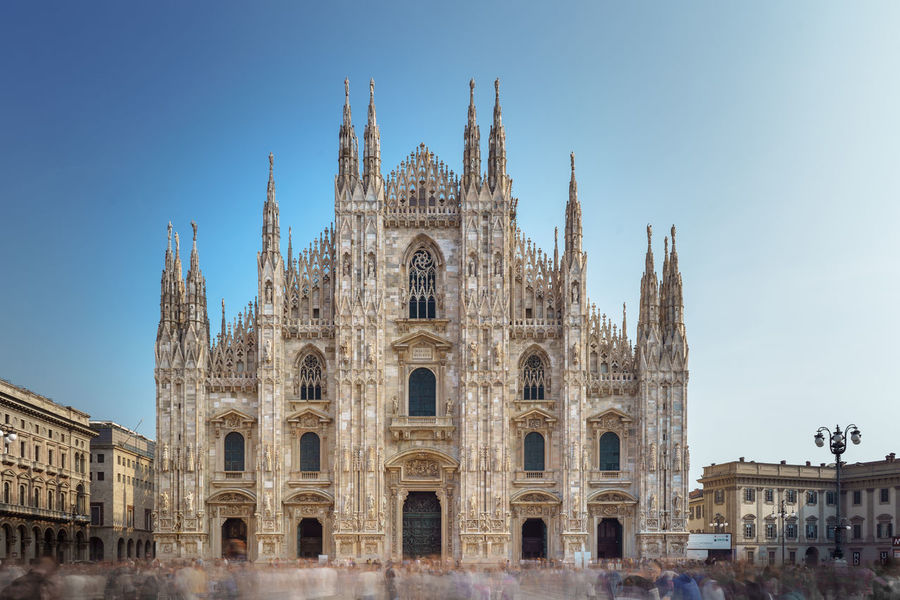 Duomo di Milano / Catholic Church Duomo Di Milano Catholic Church Built Structure Architecture Building Exterior Sky Travel Destinations Tourism History Travel Religion Building Façade Spirituality Place Of Worship Clear Sky City Day Arch Belief No People Gothic Style Ancient Civilization Spire  Long Exposure