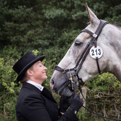 Dressage Competition Horse Trials Animal Themes Close-up Day Domestic Animals Dressage Rider Dressagehorse Eventing Horse Human Hand Lifestyles Mammal One Animal One Person Outdoors People Real People Side View Young Adult