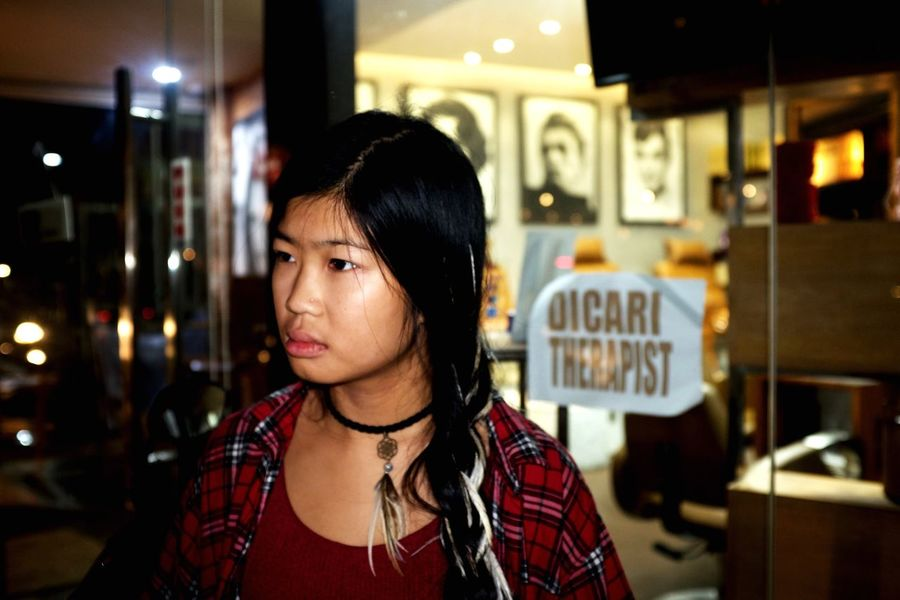 Singer songwriter Kai Mata on the streets of Ubud. Bali Asian  Young Woman Millennials EyeEm Selects One Person Headshot Real People Portrait Lifestyles Focus On Foreground Black Hair Adult Illuminated Hairstyle Looking Night Leisure Activity