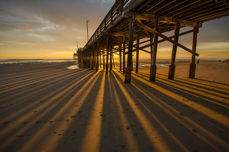 Pier, Sunset Shadows & Lights Shadows EyeEm Selects Sea Water Sunset Beach Sand Sunlight Low Tide Pier Wooden Post Coastline Ocean Shore California Dreamin EyeEmNewHere
