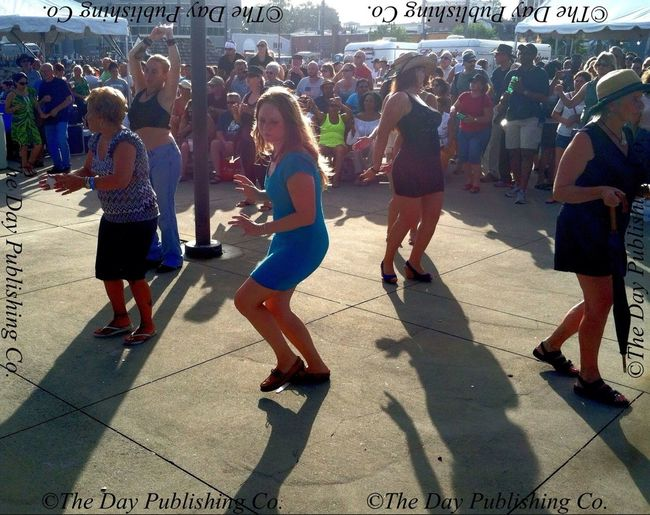 Dancing to Santa Mamba on the pier. DaySailfest