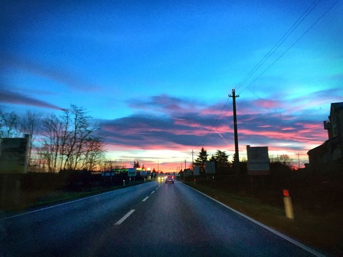 On the road Sky Road The Way Forward Transportation Direction Cloud - Sky Sunset Electricity  Nature No People Electricity Pylon Technology Connection Diminishing Perspective Tree Plant Sign City Cable Power Line