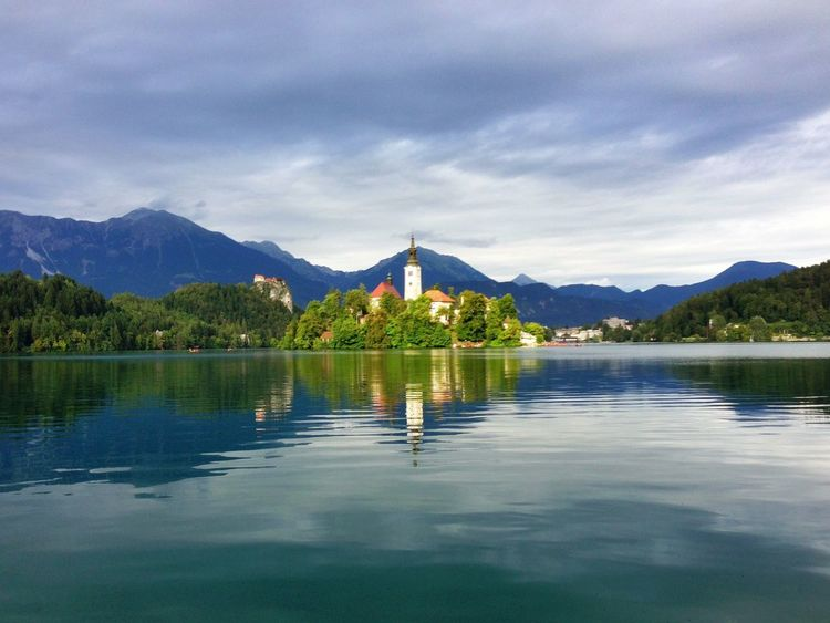 Lake Bled in Slovenia The Great Outdoors - 2016 EyeEm Awards Lake Bled, Slovenia Castle Church Blue Reflection Green Tranquility Tranquil Scene Mountain Range Water Water Reflections Idyllic Standing Water Overcast Landscape Nature Cloudy Calm Remote Found On The Roll