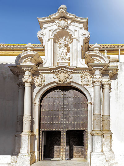 Church of San Sebastian (Side door) in Estepa, province of Seville. Charming white village in Andalusia. Southern Spain. Picturesque travel destination on Spain. Estepa Sevilla Estepa SPAIN Seville Tourism White Villages Sun Sky Europe Cityscape Andalusia Andalusian Architecture City Town Village Andalucía Travel Travel Destinations Blue Architecture Tower Summer Outdoors European  Tourist Mediterranean  Traveler Beautiful Province Street Spanish Traditional Destination Vacations Landmark