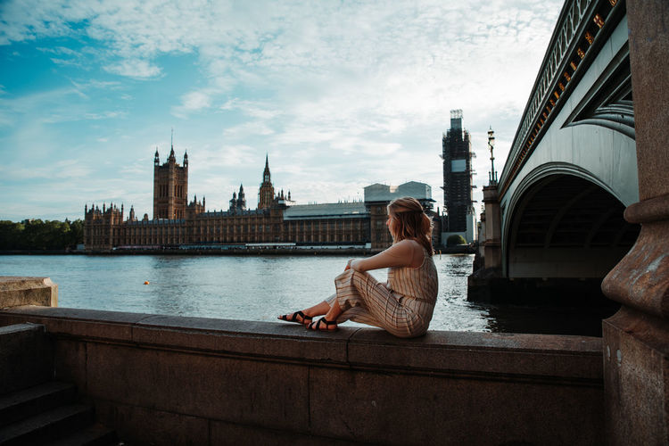 Big Ben Beuatiful Beautfildestinations Beautiful Woman London England Built Structure Architecture Building Exterior Water Sitting Real People One Person Lifestyles Leisure Activity Cloud - Sky Sky Women River City Connection Casual Clothing Nature Adult Bridge - Man Made Structure Outdoors Looking At View Hairstyle