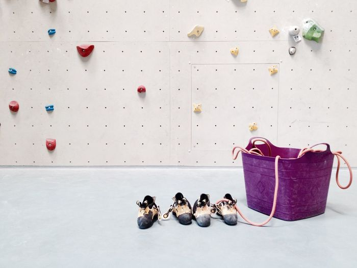 Shoes And Basket Against Climbing Wall