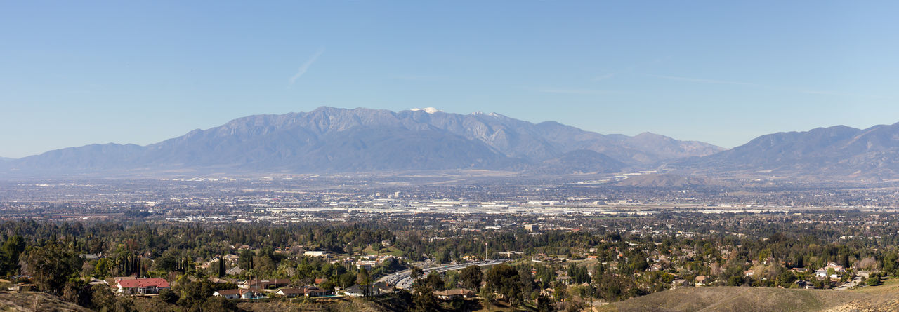 A panoramic view of Redlands and San Bernardino looking towards Mt. San Antonio Mountain Sky Mountain Range Scenics - Nature Beauty In Nature Environment Landscape Nature Day Clear Sky No People City Plant Tree Blue Outdoors Cityscape TOWNSCAPE Panorama Panoramic Panoramic View Redlands San Bernardino Southern California
