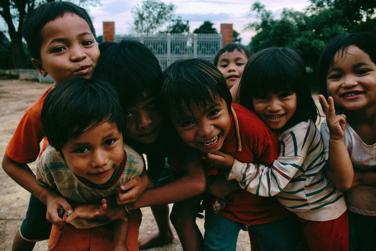 Happiness of poor children on highlands. Children Happiness Happy Life Boys Child Childhood Day Friendship Happiness Lifestyles Looking At Camera Outdoors People Poor Children Portrait Portrait Of Children Smiling