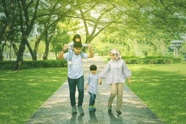 Cheerful family walking at park