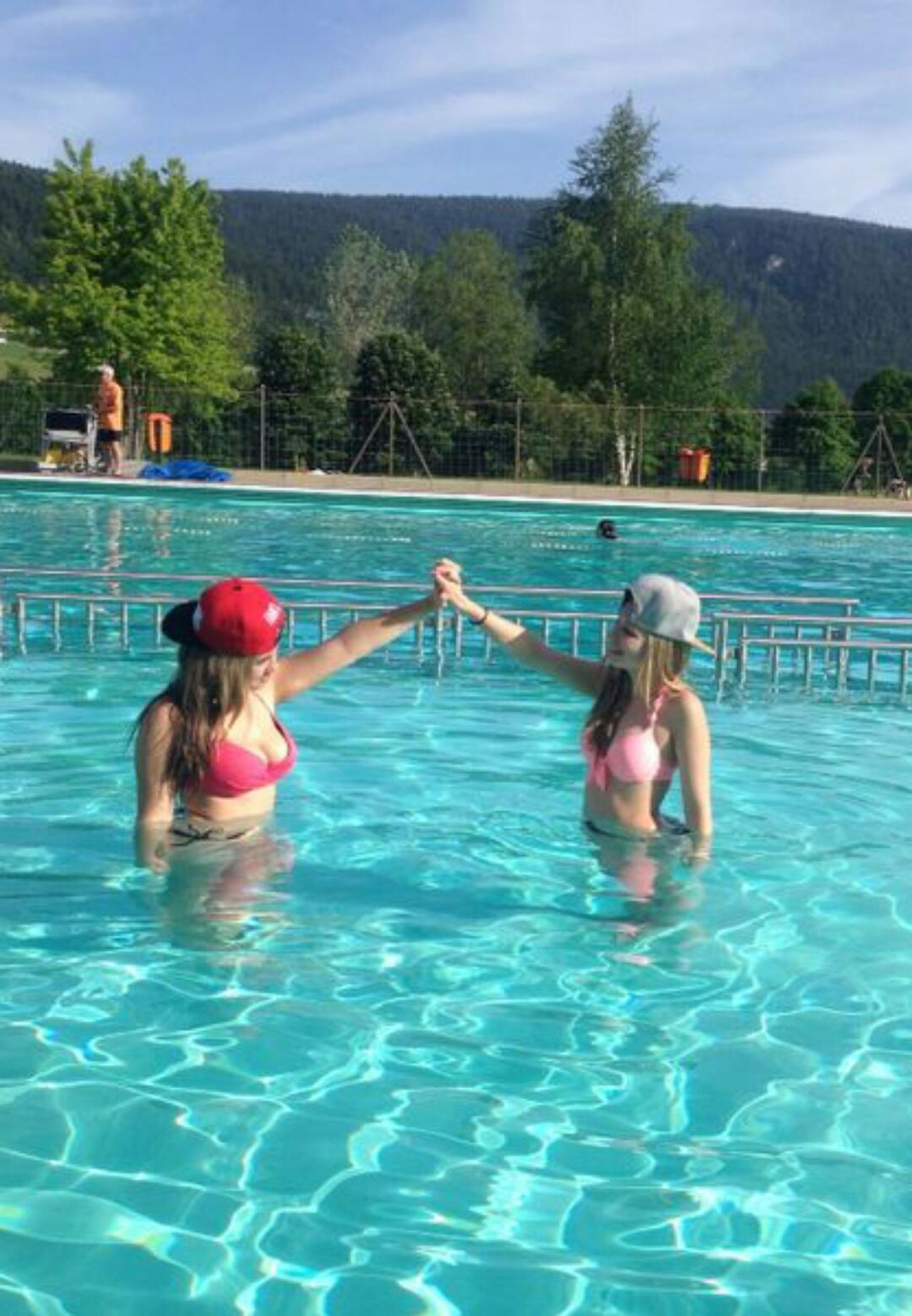 water, leisure activity, lifestyles, swimming pool, tree, waterfront, childhood, enjoyment, vacations, sky, swimming, person, full length, togetherness, fun, boys, girls, blue