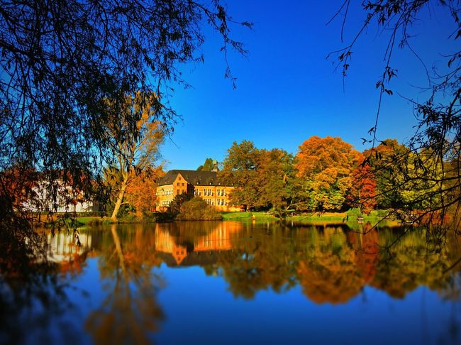 Colourful autumn in Reinbek Home Sweet Home Reflection Autumn Tree Nature Clear Sky Outdoors Beauty In Nature Lake IPhoneography IPhone First Eyeem Photo Today's Hot Look EyeEm Best Shots EyeEmBestPics Iphoneonly Beauty HDR HDR Collection Castle Water Indian Summer Scenics Tranquility
