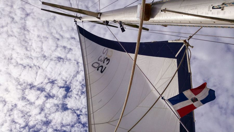 Sailor's life Boat Day Sky No People Outdoors Low Angle View Dominican Flag Mast Sails Wanderlust Getaway  Blue Clouds Travel Adventure Tropical