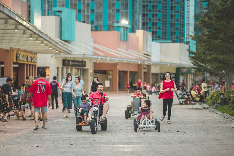 family time = go cart! Go Cart Bike Building Exterior Architecture Built Structure City Group Of People Real People Transportation Women Street Men Lifestyles Building Mode Of Transportation People Full Length Adult Day Bicycle Incidental People Child Outdoors