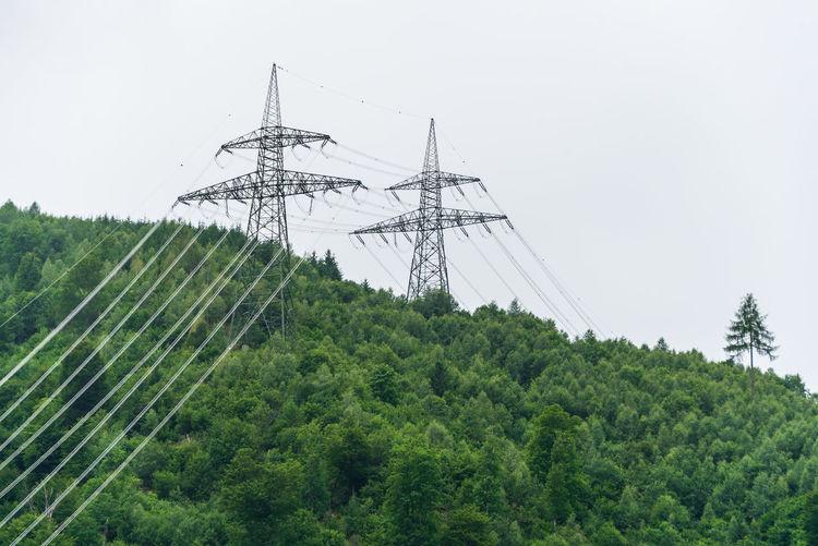 High voltage overhead power line, power pylon, steel lattice tower, mountains landscape austria.