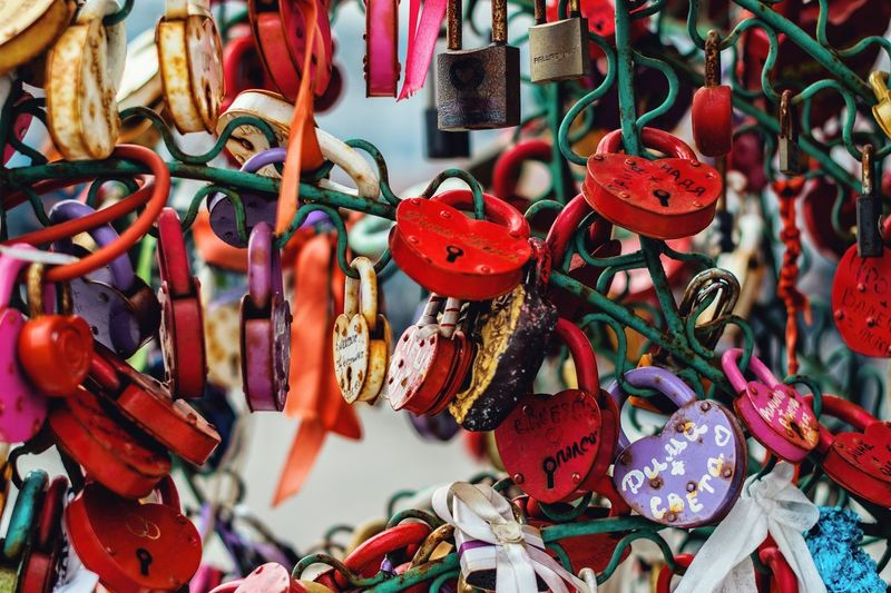 Close-up of love locks hanging outdoors