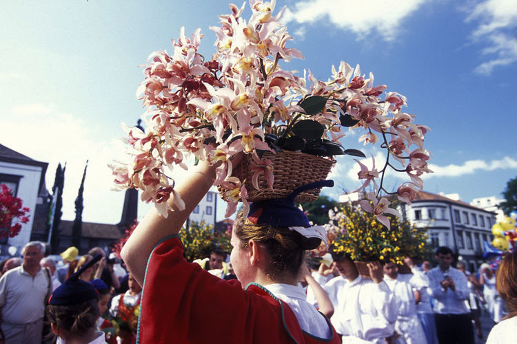 Woman Carrying Flowers In Basket Over Head During Traditional Festival