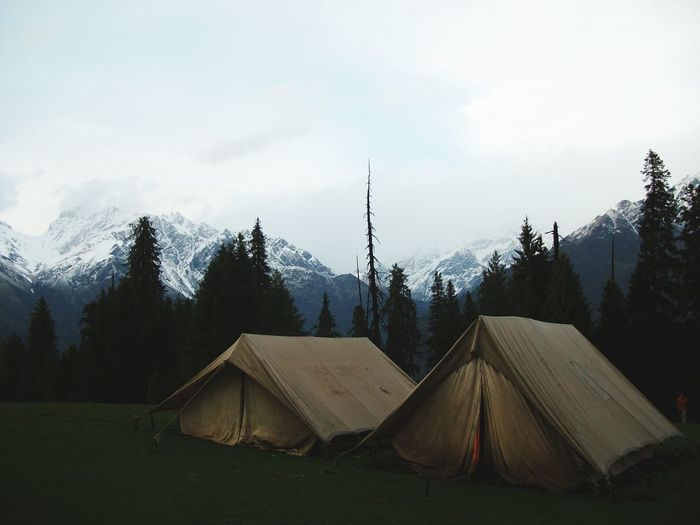 Tent By Snowcapped Mountain Against Sky