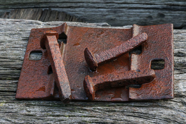 Abandoned Bad Condition Close-up Damaged Day Deterioration Girder Hinges History Metal Nails No People Outdoors Run-down Rustic Rusty Water Weathered Wood Wood - Material
