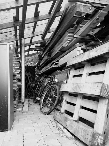 Wooden storage Architecture Transportation Built Structure Mode Of Transportation Land Vehicle No People Day Indoors  Building Stationary Shopping Motor Vehicle Wheel Sunlight Garage Abandoned Parking Garage Parking Lot Damaged Ceiling