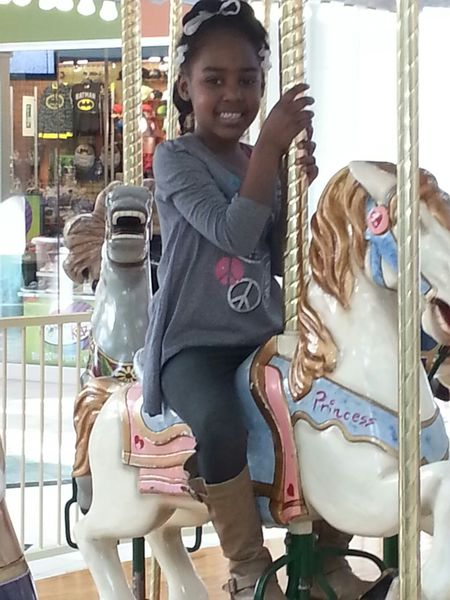 ciara enjoying the carousel!