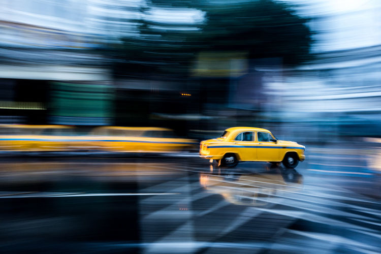 Blurred motion of taxi on street in city