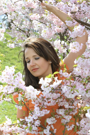 Beautiful young woman, enjoying cherry blossoms in spring time Beautiful Cherry Blossoms Fun Funny Happiness Woman Beauty Beauty In Nature Blooming Blossom Cherry Tree Flower Fragility Girl Leisure Leisure Activity Lifestyles Nature One Person Pretty Scented Smelling Spring Time Springtime Young Adult