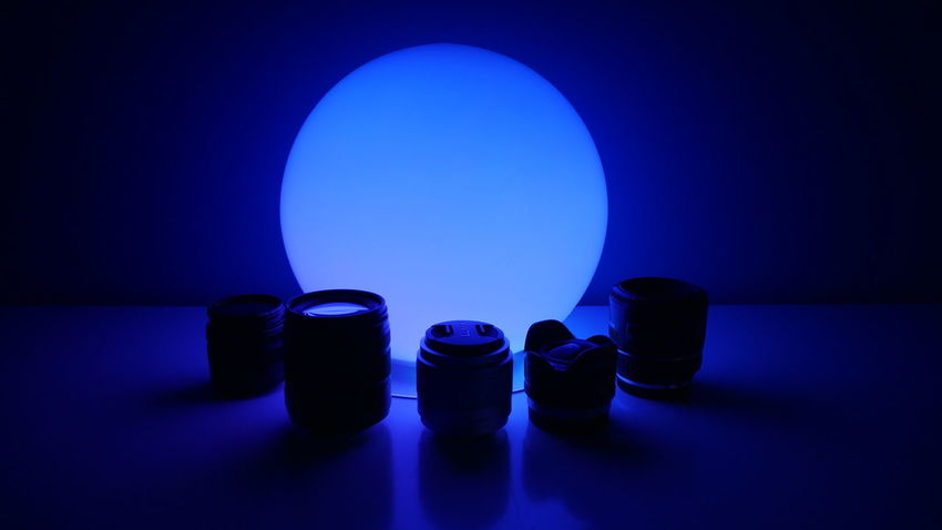 Lens Kit Blue Blue Background Close-up Colored Background Dark Drinking Glass Glass Glass - Material Group Of Objects Healthcare And Medicine Household Equipment Illuminated Indoors  Lens Lenses Medicine No People Simplicity Still Life Studio Shot Table Vignette