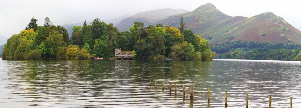 A panoramic taken in Keswick Mountain Tree Water Beauty In Nature Lake Scenics Nature Tranquility Tranquil Scene Day Waterfront Outdoors Mountain Range Transportation No People Nautical Vessel Growth Sky