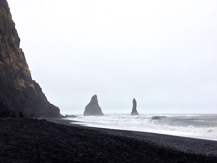 Iceland Stone Volcanic  Black Sand Beach Volcanic Landscape Sea Water Sky Beach Land Nature Rock Formation Rock Scenics - Nature Solid Rock - Object Beauty In Nature Horizon Over Water Horizon Day Clear Sky Tranquility Tranquil Scene Outdoors