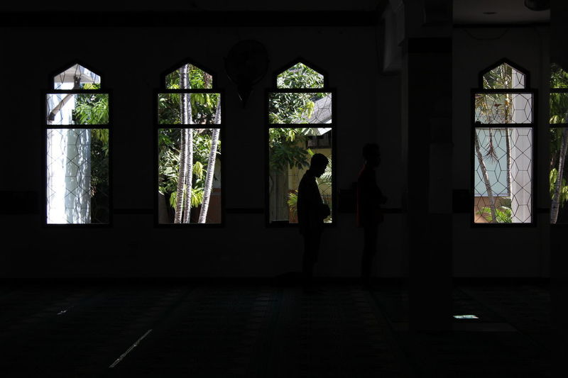 mosque Adult Architecture Building Built Structure Dark Day Flooring Full Length Glass - Material Indoors  Leisure Activity Lifestyles Men People Real People Silhouette Standing Teenager Two People Window Women