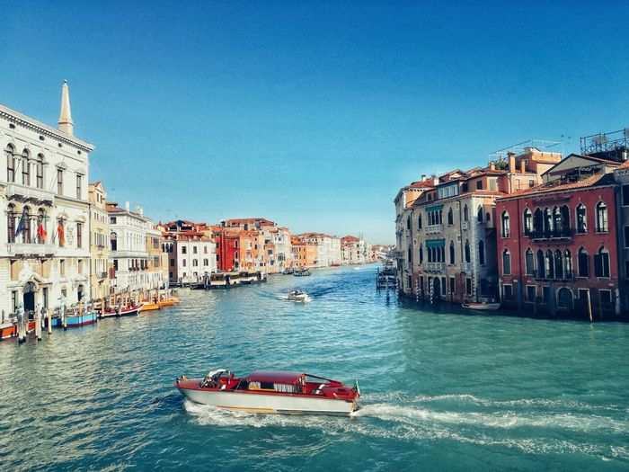POSTCARD Gondola - Traditional Boat Water Nautical Vessel Clear Sky Cultures City Sky Architecture Building Exterior Built Structure Canal Motorboat Grand Canal - Venice Venice - Italy Mooring Post Veneto Venetian Lagoon Water Vehicle Boat Gondola Speedboat Wake - Water