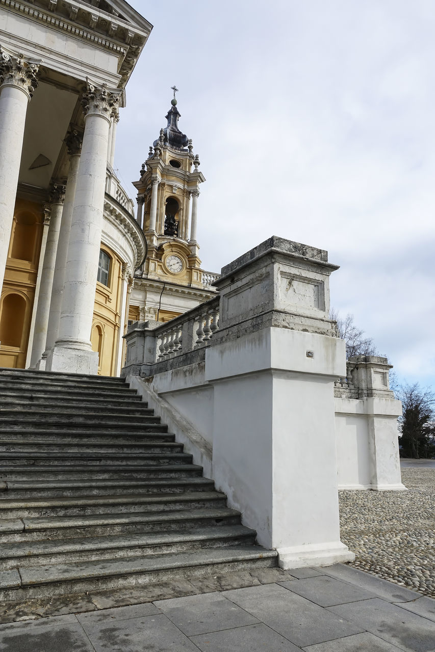 architecture, built structure, building exterior, low angle view, sky, staircase, history, the past, building, place of worship, belief, no people, cloud - sky, religion, spirituality, day, nature, travel destinations, architectural column, steps and staircases, outdoors