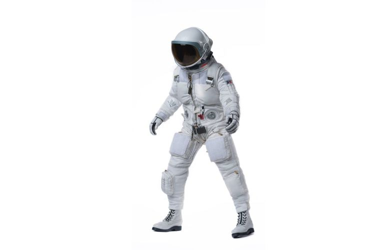 Man in space suit standing against white background