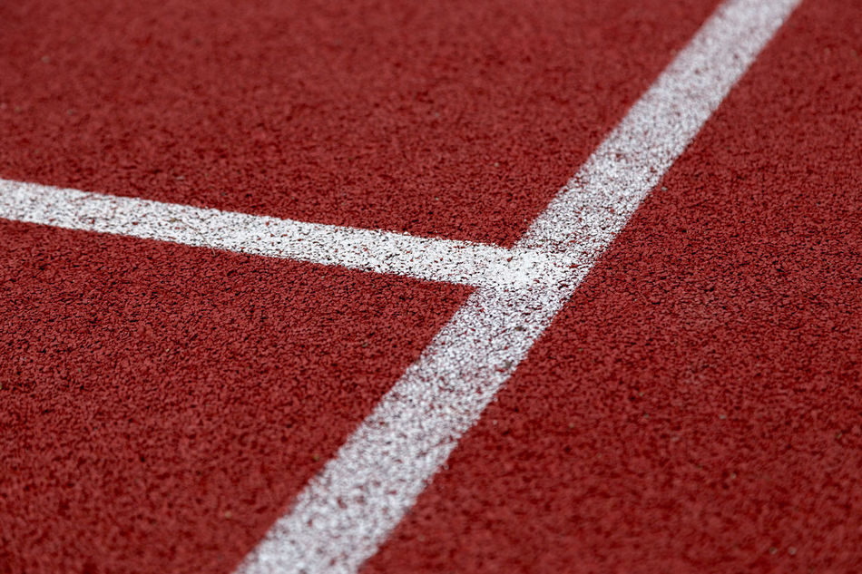 Track and field lines Backgrounds Close-up Competition Competitive Sport Day Exercising Finish Line  Leichtathletik No People Outdoors Playing Field Red Running Track Sport Sports Race Sports Track Sprinting Stadium Starting Line Tartan Textured  Track And Field Track And Field Athlete Track And Field Stadium Track Event