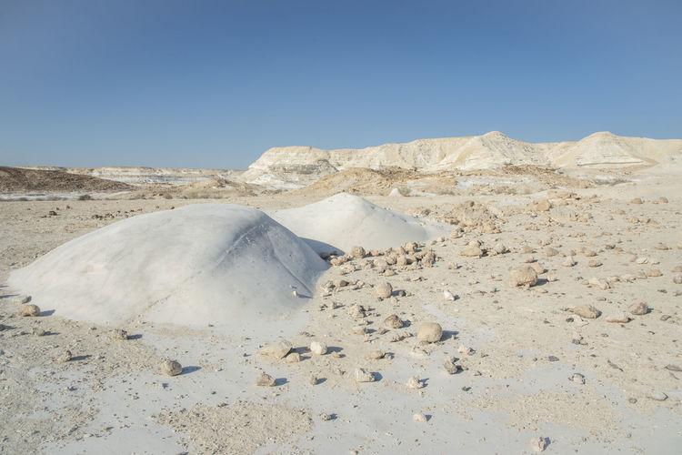 Beautiful lunar landscape. wight and smooth hills in desert landscape. rounded chalk rocks. israel.