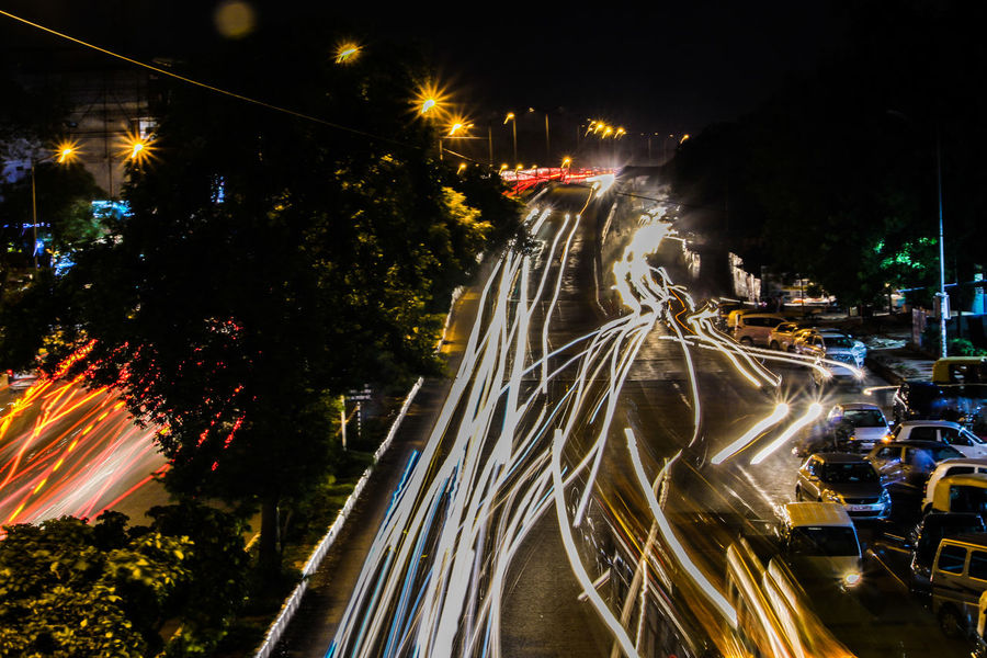 Lines. Night Illuminated Traffic Light Trail Long Exposure Car Street Light Motion Speed Street City City Street City Life Outdoors Road Tree Transportation Vehicle Light Aerial View